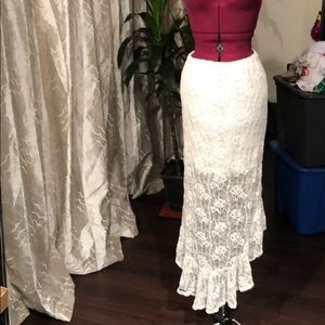 Asymmetric white lace skirt